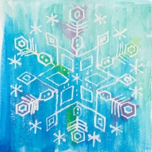 Image shows a water colour painting of a snowflake