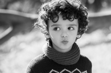 curly haired girl with big eyes in jumper.jpeg