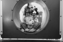 Boy in play tunnel