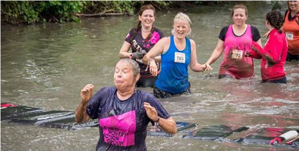 Trafford Housing Trust supporters doing the Filthy Girl Mud Run